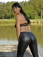 Desyra Noir posing in nature dressed in black | MyBigMILFBooty.com